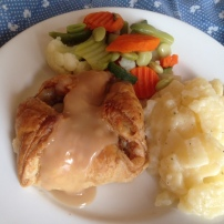 Beef Wellington with Scalloped Potatoes and Mixed Vegetables.