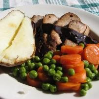Marinated Pork Tenderloin, Baked Potato and Vegetables.
