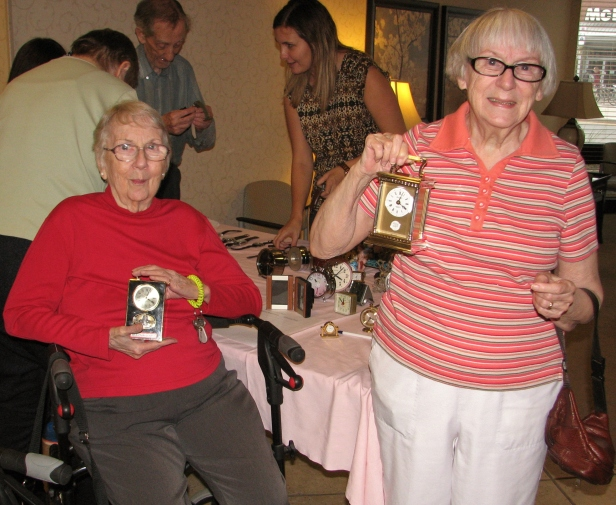 Our auction winners of the two big-ticket Bulova clocks.
