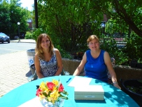 Melissa and Susan greet guests at the registration table